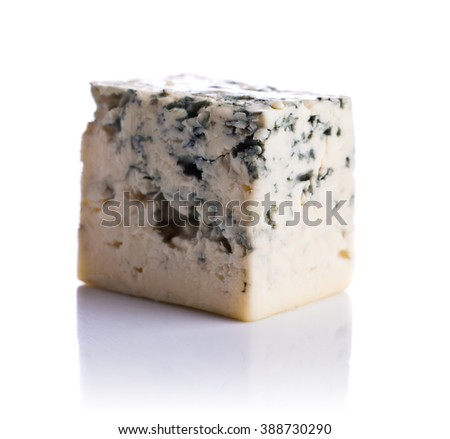 Blue cheese isolated on a white reflective background