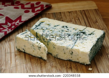 Blue cheese on wooden board - stock photo
