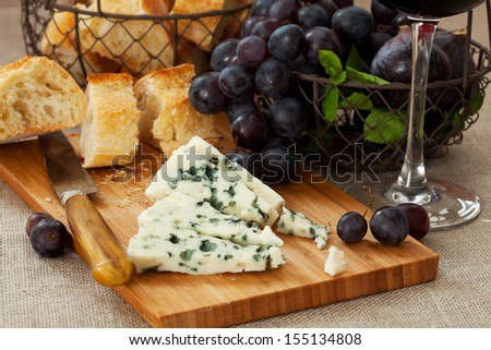 Blue cheese with a glass of red wine