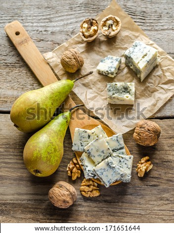 Blue cheese with pears and walnuts - stock photo