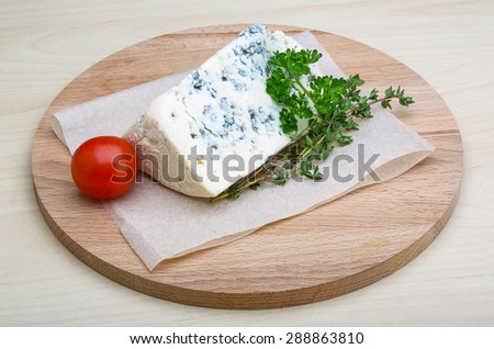 Blue cheese with thyme, tomato and parsley - stock photo
