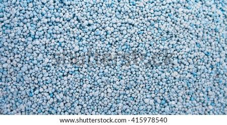 blue chemical fertilizer background. - stock photo