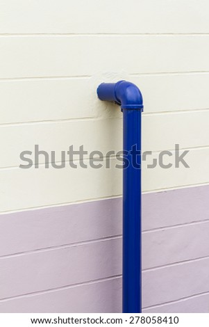Blue chemical industrial pipe on the wall - stock photo