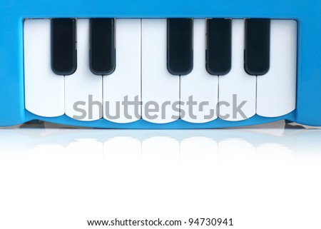 Blue child's piano on a white background - stock photo