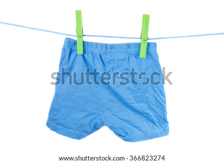 blue children's shorts on the clothesline on a white background