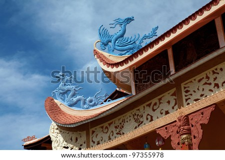 Blue Chinese dragons on the rooftop of a monastery.