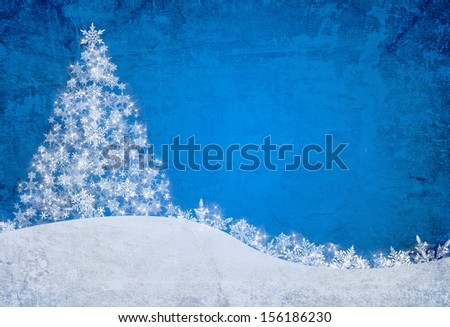 blue christmas background with snowflakes and pine tree - stock photo
