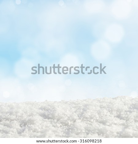 Blue Christmas background with various bokeh and snow drifts - stock photo