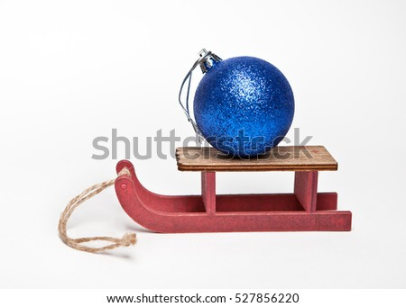 Blue Christmas ball on a wooden sledge