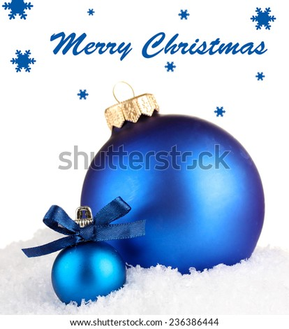 Blue Christmas balls and silver ribbon in snow isolated on white - stock photo