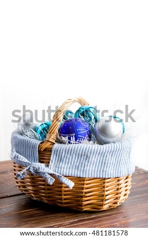 blue Christmas balls in  basket on white background
