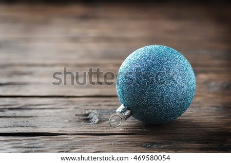 Blue christmas balls on the wooden table, selective focus