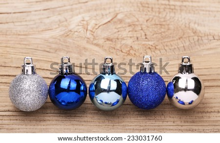 Blue Christmas Balls Over Wooden Background - stock photo