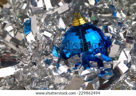 blue christmas bauble in a silver chain