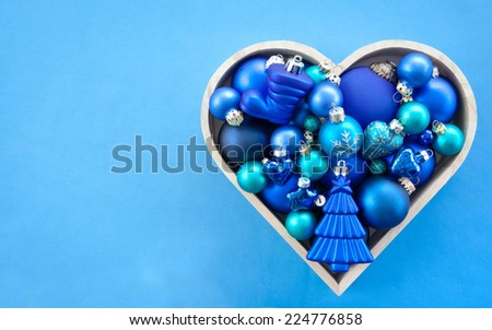 Blue christmas baubles arranged in a tree shape - stock photo