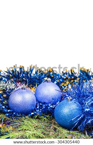 blue Christmas baubles on green spruce tree branch isolated on white background