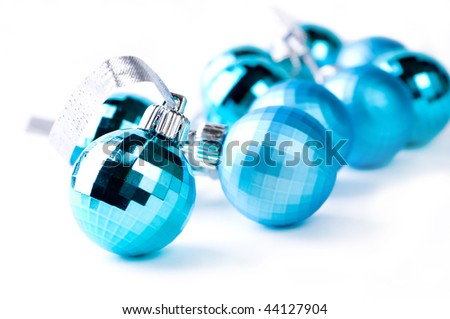 Blue Christmas baubles with silver decoration, isolated