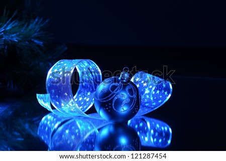 Blue Christmas collage. Ball and ribbon on a blue background. - stock photo