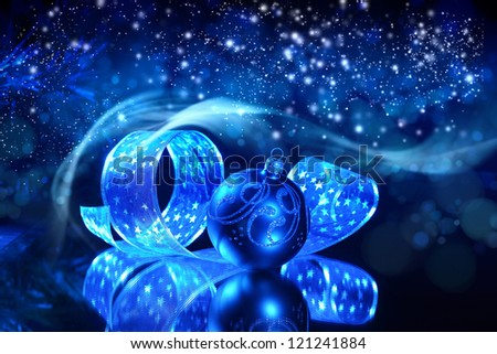 Blue Christmas collage. Decorations and ribbons on a blue background - stock photo