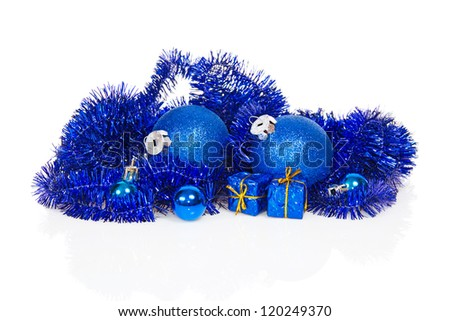 Blue christmas decoration and blue tinsel isolated on white