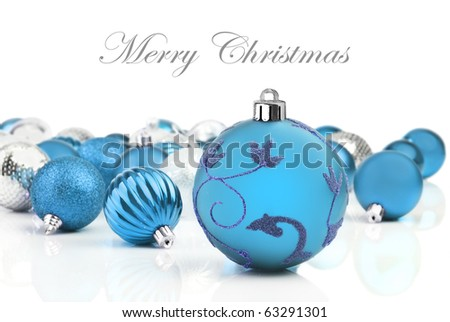 Blue christmas decorations on a white background with space for text