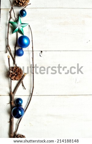 Blue Christmas ornament balls with pine cones - stock photo