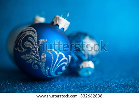 Blue christmas ornaments on dark blue glitter background with space for text. Merry christmas card. Winter holidays. Xmas theme. - stock photo