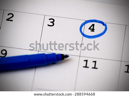 Blue circle. Mark on the calendar at 4. - stock photo