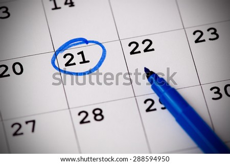 Blue circle. Mark on the calendar at 21. - stock photo