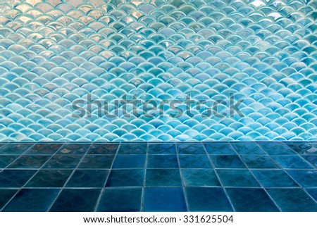 Blue circle wave tile wall and blue floor tile - stock photo