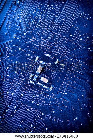 blue circuit board background of computer motherboard - stock photo