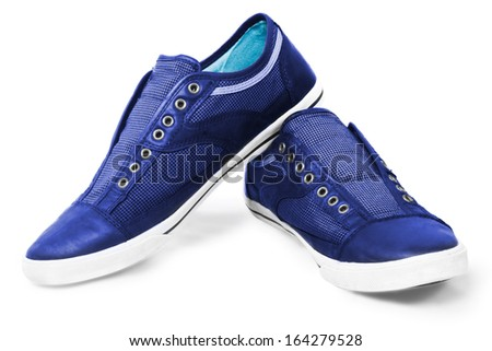 Blue classic sneakers isolated over white - stock photo