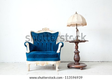 Blue classical style Armchair sofa couch in vintage room with desk lamp