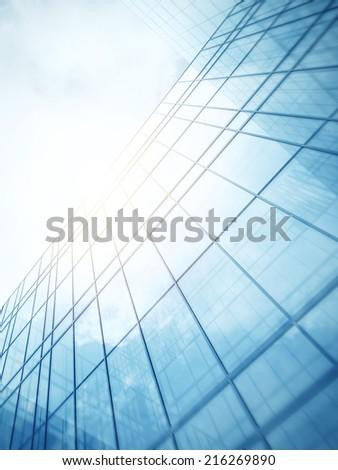 Blue clean glass wall of modern skyscraper - stock photo