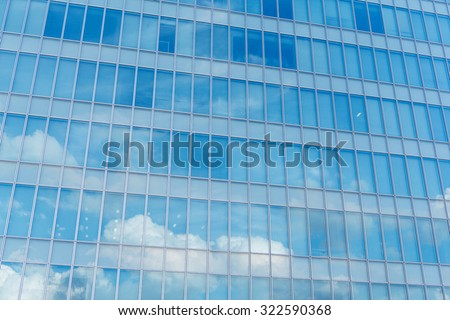 Blue clean glass wall of modern skyscraper - stock photo