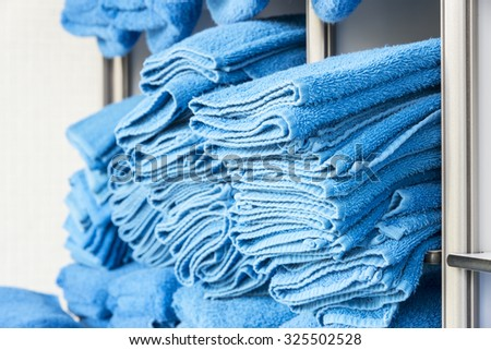 Blue, clean towels on the shelves.
