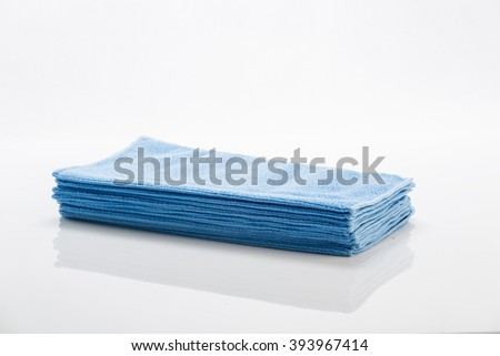 Blue cleaning clothes isolated on white background