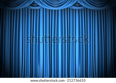 Blue closed the curtain, lit by a spotlight - stock photo