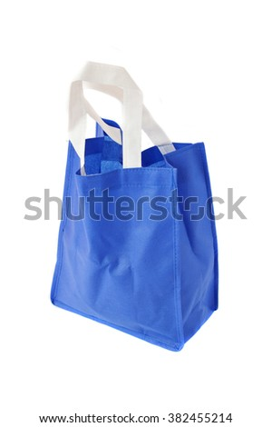 blue cloth bag on white background - stock photo