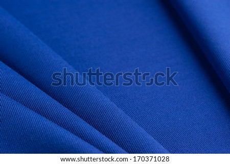 Blue cloth with straight folds texture closeup - stock photo