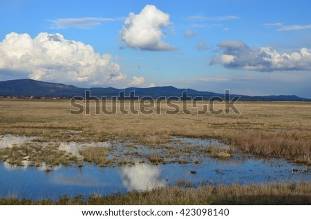 blue clouds and landscape