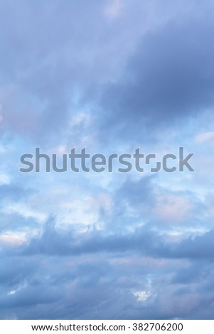 blue clouds in sky in winter evening - stock photo