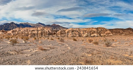 Blue cloudy sky and mountains in Nevada - stock photo
