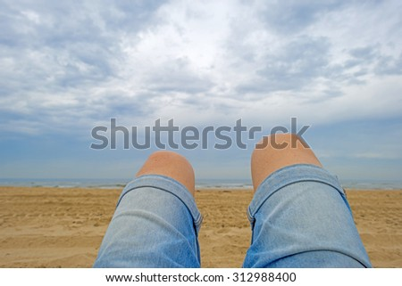 Blue cloudy sky over a beach along the North Sea - stock photo