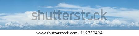 Blue cloudy sky. Panoramic shot. - stock photo