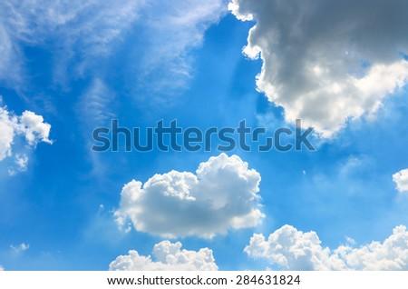 Blue cloudy sky. Vivid blue sky. Soft cloud sky. Abstract blue sky. Abstract soft cloud and sky. Daylight sky background. Sky and clouds environment. Vivid nature environment. Skyscape environment. - stock photo