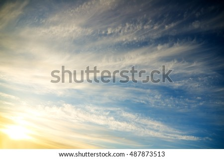 Blue cloudy sky with clouds on sunset