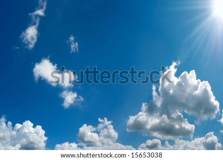 blue cloudy sky with sun - stock photo
