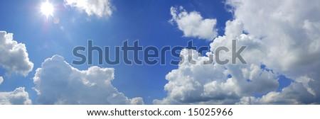 blue cloudy sky with sun panorama - stock photo