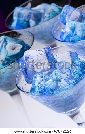 Blue cocktail and ice. Cold  alcoholic drink